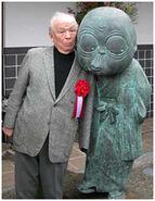Mizuki with NonNonBa statue