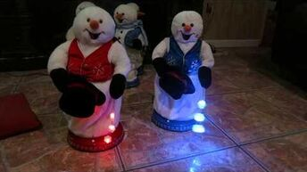 2005 Gemmy spinning snowflake snowmen (red and blue snowflake vest)