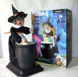 Animated witch with skull in pot