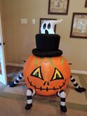 Gemmy inflatable ghost behind pumpkin spider