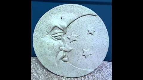 Animated musical Moon plaque