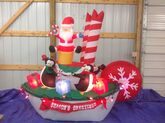 Gemmy animated inflatable santa and penguins in christmas tugboat