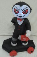 Gemmy inflatable vampire on coffin skateboard