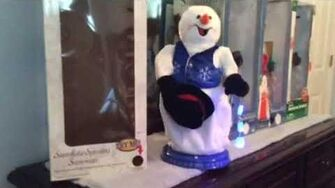 Gemmy Low pitched blue snowflake vest spinning snowflake snowman