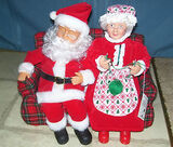 Animated Claus couple on couch