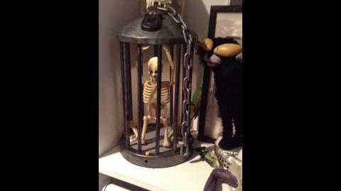 Gemmy he's gotta go caged skeleton