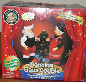 Gemmy dancing claus couple