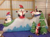 Gemmy inflatable winter wonderland friend sledding