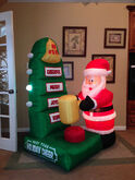 Gemmy animated inflatable santa at holiday cheer meter game