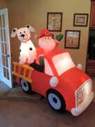 Gemmy inflatable Santa in fire truck with dalmatian