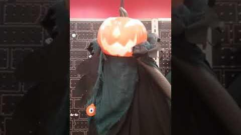 Gemmy hanging talking pumpkin headed ghoul