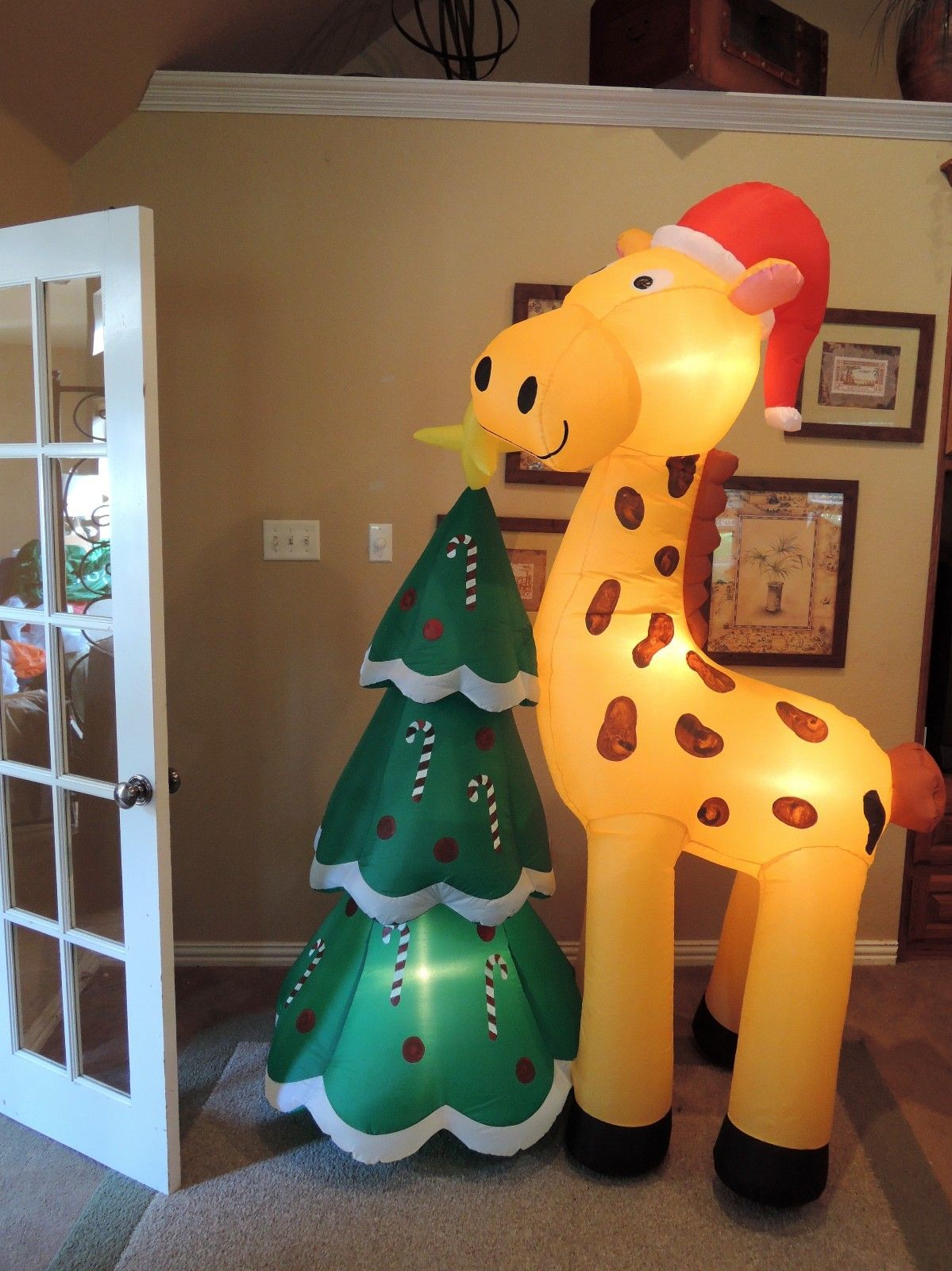Gemmy Inflatable Giraffe With Christmas Tree.JPG