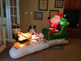 Gemmy inflatable santa with dogs as reindeer