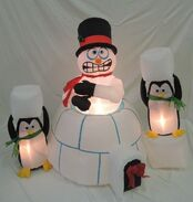 Gemmy inflatable snowman and penguins in igloo