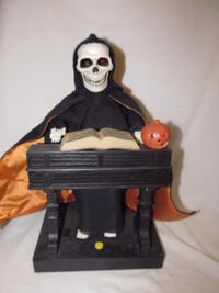 Gemmy animated grim reaper at his organ 1995