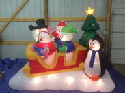 Gemmy inflatable snowman and penguin sleigh scene