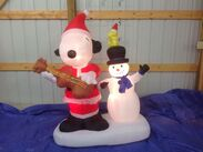 Gemmy animated inflatable snoopy playing giutar with snowman while dancing