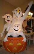 Gemmy inflatable ghost trio in pumpkin