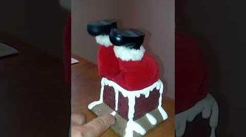 Santa Stuck in Chimney Toy
