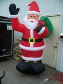 Gemmy inflatable santa with bage over back