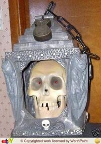 Halloween animated talking and singing skull in lantern