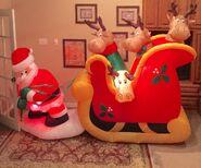 Gemmy Prototype Christmas Santa Pulling Reindeer in Sleigh Inflatable Airblown