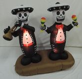 Gemmy inflatable mexican skeletons