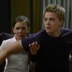 Michael protects Kristina when Warren tries to kill her