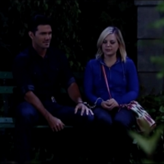 Maxie and Nathan sit in the park on the their way home