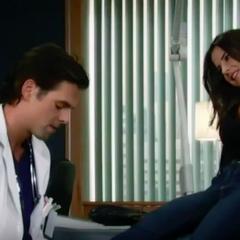 Patrick checks Sam's ankle