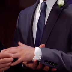 Lucas puts the ring on Brad's finger