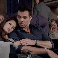 Sam asleep on Patrick's shoulder (on an airplane)