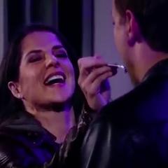 Sam feeds Jason cake