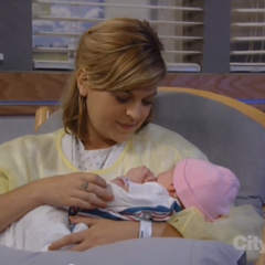 Maxie holds her daughter for the first time
