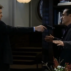 Michael holds Sonny at gunpoint and almost kills him