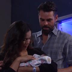 Sabrina holds Gabriel