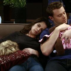Jason and Sam cuddle with their children