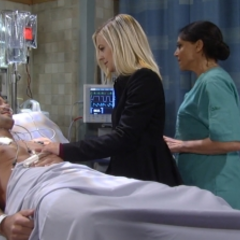 Maxie holds Nathan's hand in the E.R.