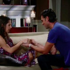 Patrick puts one of Emma's toy rings on Sam's finger