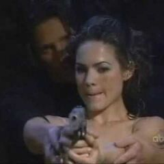 Jason teaches Elizabeth how to handle a gun