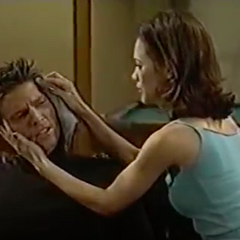 Liz tends to the cut on Jason's head