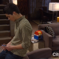 Rafe looks at his prom ticket before ripping it up