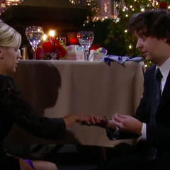 Putting the ring on Maxie's finger even thou she didn't say yes