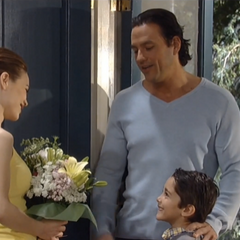 Spencer, along with his father, Nikolas, bring Elizabeth flowers