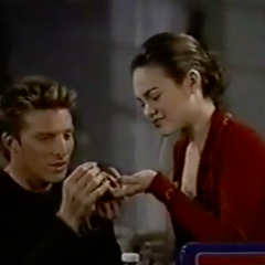 Jason gets a splinter out of Elizabeth's finger