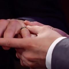 Brad puts the ring on Lucas' finger