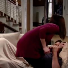 Jason grabs Elizabeth's wrist