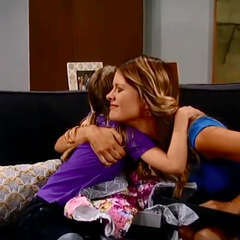 Hugging after Nina brings Charlotte a dress/Happy you're living with your mother