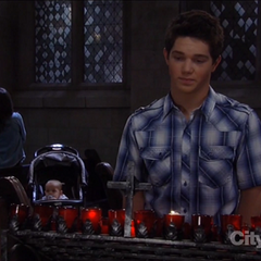 Rafe lights a candle for his mother