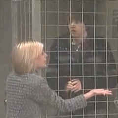 Maxie tries to calm Spinelli down while he's in a holding cell
